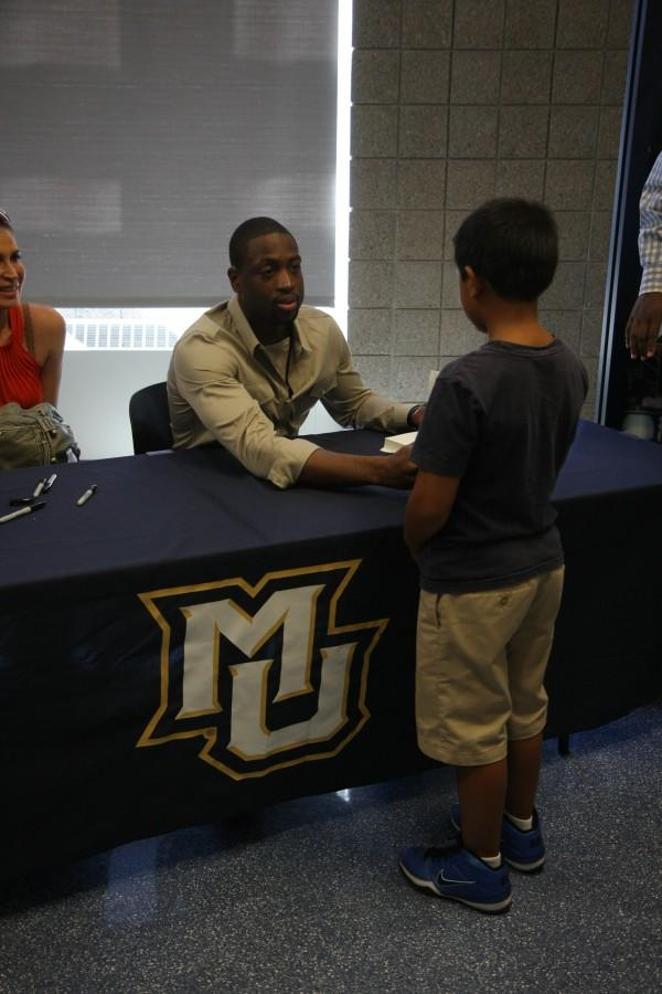 Wade returns to Marquette for book signing