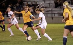 Women's soccer opens season with two road losses