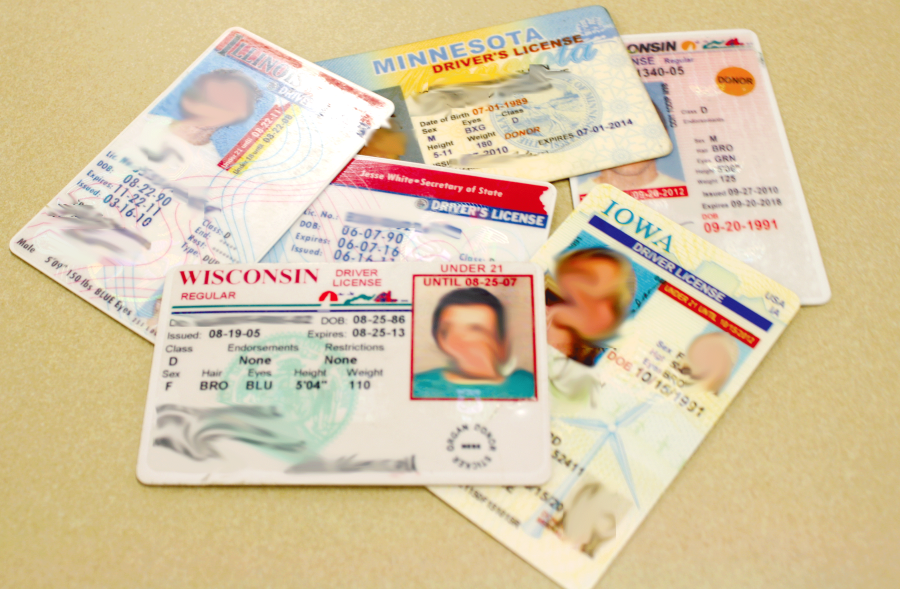 Fake ID's pile up in Marquette student's wallets. Photo by Erin Caughey/erin.caughey@marquette.edu