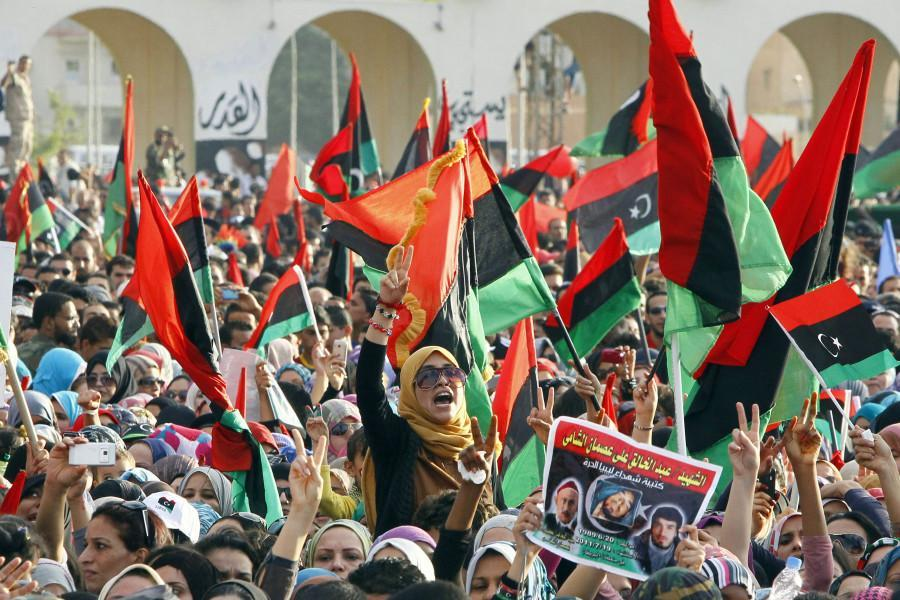 Libyans celebrate as they hear news of long-time leaders death. Photo by Francois Mori/ Associated Press