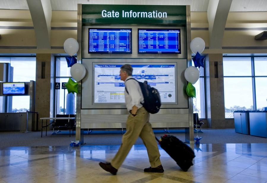 Frontier airlines will cut 120 in Milwaukee to help keep the airline out of financial straits (AP Photo/Orange County Register, Michael Goulding)