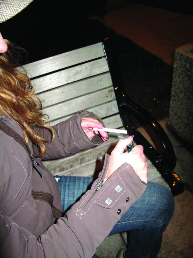 Spark, a campus group trying to ban smoking, drew chalk lines to deter smokers from lighting it up near buildings. Photo by Elise Krivit/elise.krivit@marquette.edu