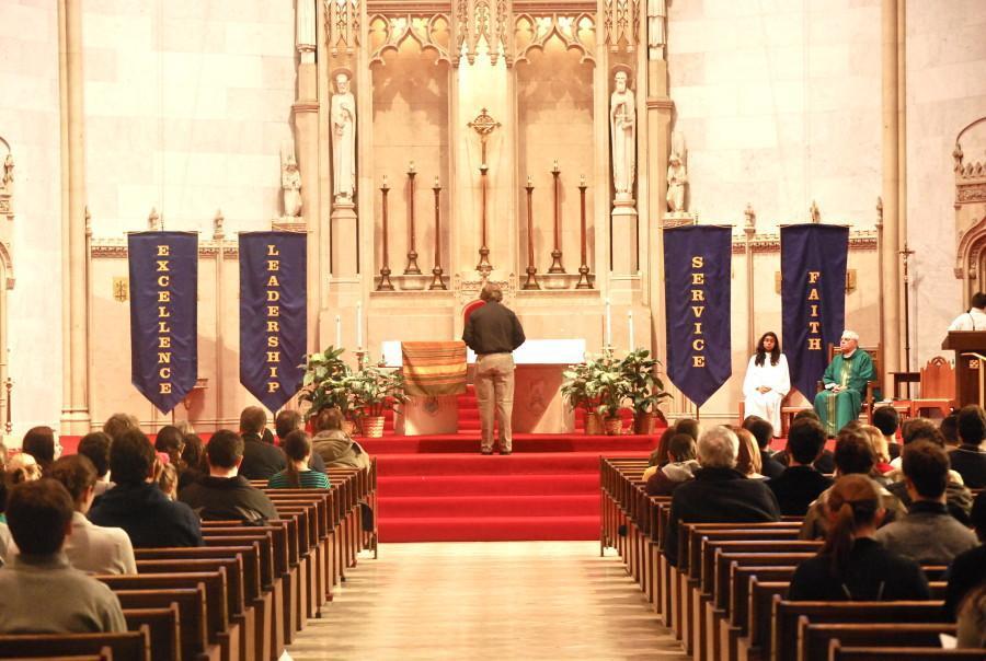 Rev. Douglas J. Leonhardt, S.J. presides over the Mission Week mass this past Sunday, Feb 19, 2012. Photo by Rebecca Rebholz/rebecca.rebholz@marquette.edu