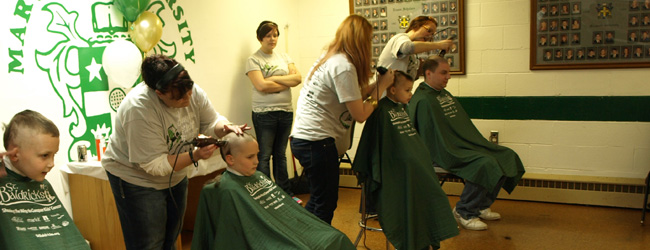 Students shaved their heads on Saturday to raise money to find cures for childhood cancers.