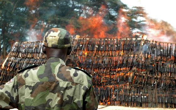 In this photo taken Oct. 5, 2009, soldiers of the Uganda Peoples Defence Army burn a heap of about 3500 confiscated illegal arms, recovered from Lords Resistance Army (LRA) rebels caches and robbers throughout Uganda, and ranging from AK47s to machine guns, in Kampala, Uganda. The voices demanding that the U.S. Congress stop the brutality of African warlord Joseph Kony and his LRA belong to the nation's children, some of whose parents work in Congress. (AP Photo/Stephen Wandera)