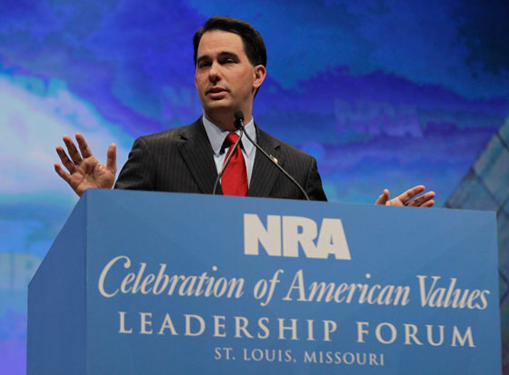 In this April 13, 2012, photo Wisconsin Gov. Scott Walker speaks at the National Rifle Association convention in St. Louis, Mo. A year after his showdown with labor protesters, the Wisconsin governor has become one of the most sought-after figures in the Republican Party, keeping a jet-setting travel schedule more akin to a presidential candidate than a governor trying to survive a recall challenge. (AP Photo/Michael Conroy)