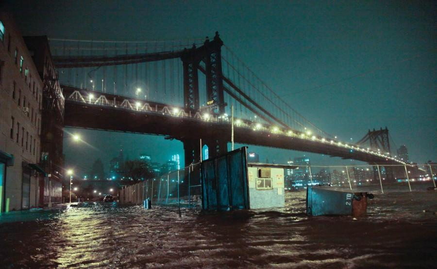 Streets are flooded under the Manhattan Bridge in the Dumbo section of Brooklyn, N.Y., Monday, Oct. 29, 2012. Sandy continued on its path Monday, as the storm forced the shutdown of mass transit, schools and financial markets, sending coastal residents fleeing, and threatening a dangerous mix of high winds and soaking rain. (Photo by Bebeto Matthews/ Associated Press)