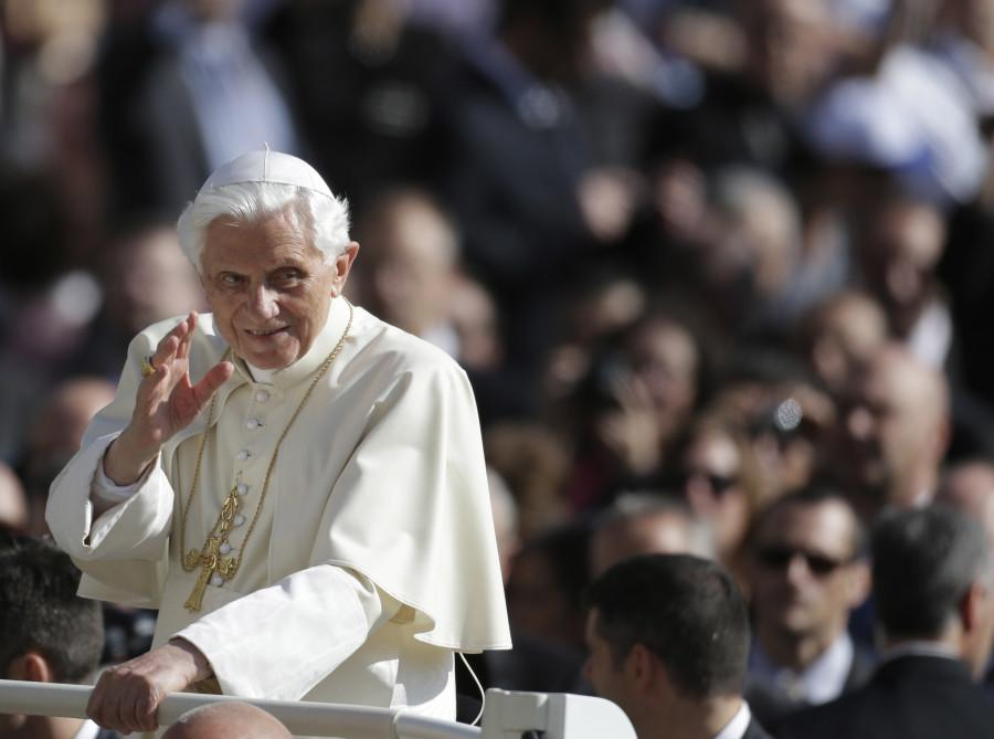 Pope Benedict XVI blesses the faithful during the weekly general audience in St. Peter's square at the Vatican, Wednesday, Oct. 10, 2012. (Photo by Alessandra Tarantino/ Associated Press)