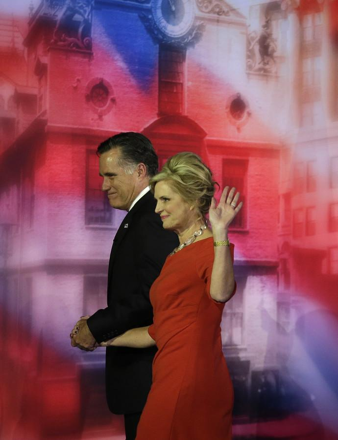Republican presidential candidate and former Massachusetts Gov. Mitt Romney and his wife Ann walk off the stage after Romney conceded the race during his election night rally, Wednesday, Nov. 7, 2012, in Boston. Photo by Elise Amendola/ Associated Press