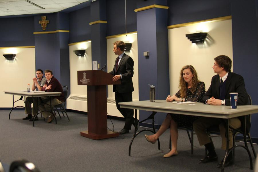 Dan Bresnahan, Will Knight, Michaela Tarpey and Thomas Schick, the candidates originally slotted to face off in the MUSG general election, participate in a debate Sunday night moderated by MUSG Elections Coordinator David Kuester. Photo by Vale Cardenas/ valeria.cardenas@mu.edu
