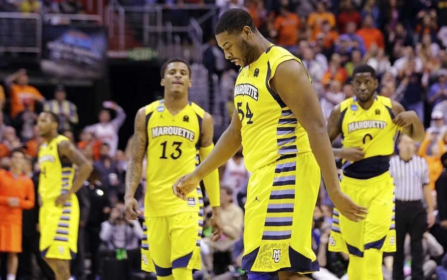 Marquette forward Davante Gardner (54), guard Vander Blue (13) and forward Jamil Wilson (0) walk off the court after their 55-39 loss to Syracuse in the East Regional final of the NCAA men's college basketball tournament, Saturday, March 30, 2013, in Washington. (AP Photo/Alex Brandon)