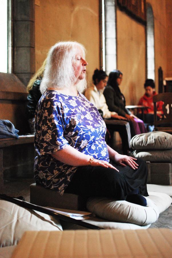 Alice Gormley, a librarian at Raynor Library and member of the Marquette Contemplative Community, leads the group through different meditation techniques to relieve stress.   Photo by Rebecca Rebholz/rebecca.rebholz@mu.edu