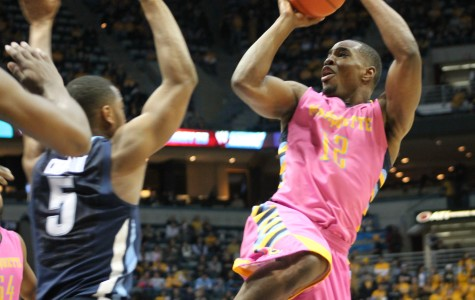 Harrison's hot shooting proves too much for Marquette