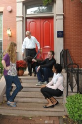 The Rev. Timothy J. O'Brien greets former Les Aspin interns with his dog Buppy outside the Les Aspin Center in D.C. The center is down the street from the student apartment building that was named in O'Brien's honor. Photo courtesy of the Les Aspin Center.