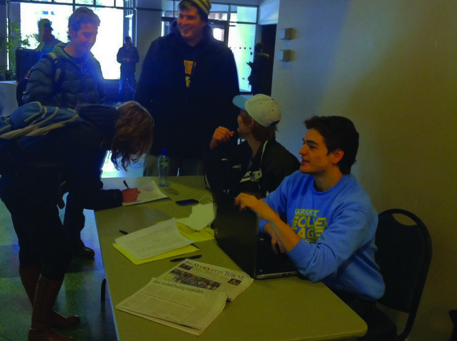 The Marquette Club Hockey team petitions to reinstate the bus services for students to attend its games. The buses were suspended following an incident involving illegal drugs last semester. Photo by Andrew Dawson.