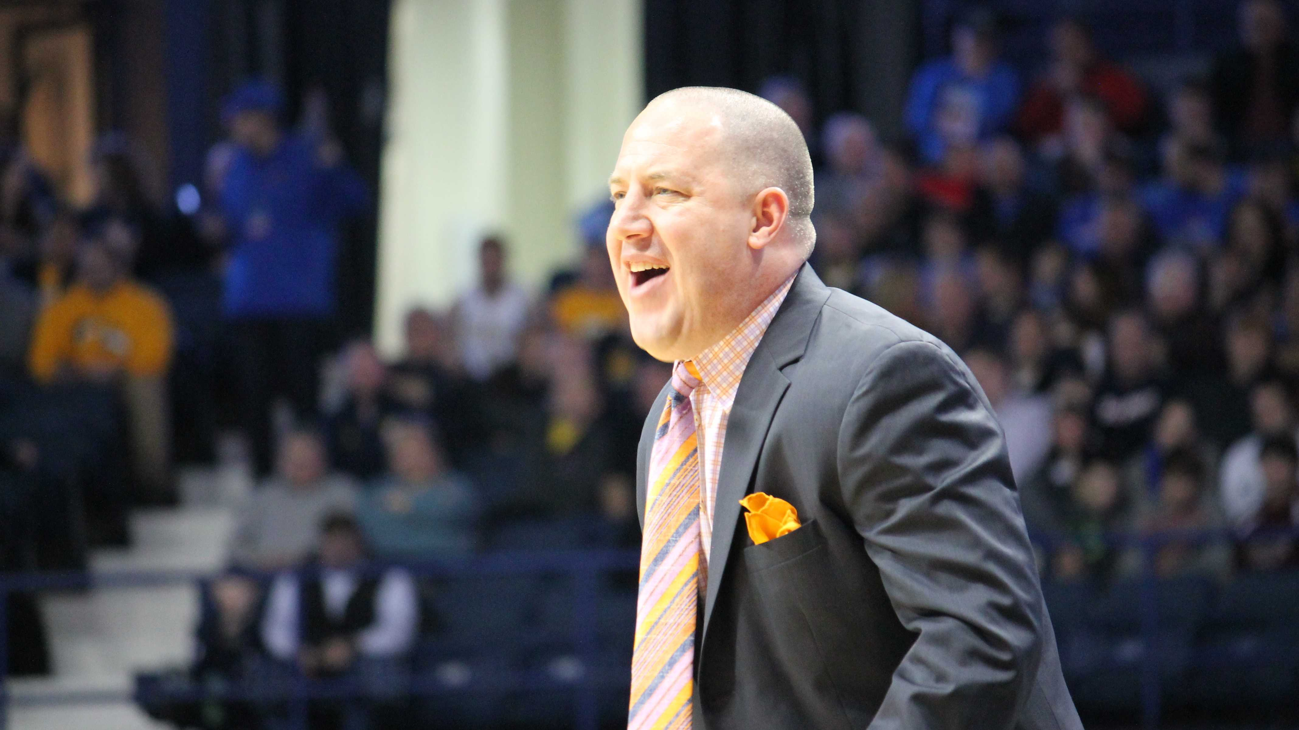 Buzz Williams during Marquette's game at DePaul on 2/22/14. (Photo by Francesca Reed / francesca.reed@marquette.edu)