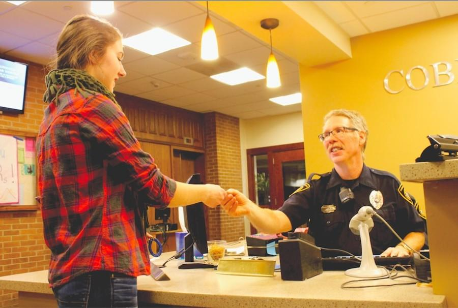 DPS officer checks student into dorm