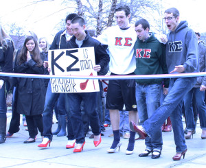 "Members of the Kappa Sigma fraternity Carlos Soria, Ryan Woo, Matt McCarthy, Dennis Aloia and Alex Busbee take part in Alpha Chi Omega's ""Walk A Mile in Her Shoes"" event, which aims to raise awareness for sexual violence."