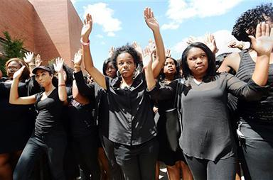 Law students at North Carolina Central University including Chenae Hammond, center, walk in the