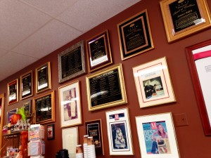 An entire wall covered in plaques, old newspaper articles and awards welcomes patrons to Simma's.
