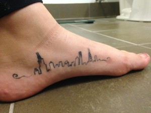 Tesia Wyszomirski shows off her love for Chicago with her tattoo. Photo by Hannah Byron/ hannah.byron@mu.edu