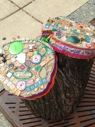 Evelyn Patricia Terry's bedazzled tree stumps use art to spread inspirational messages near bus stops. Photo courtesy of Linda Pollock.