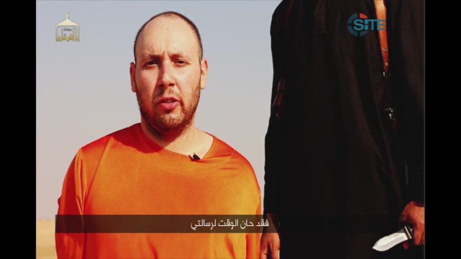 This image made from video posted on the Internet by Islamic State militants and provided by the SITE Intelligence Group, a U.S. terrorism watchdog, on Tuesday, Sept. 2, 2014, purports to show journalist Steven Sotloff before he was beheaded.