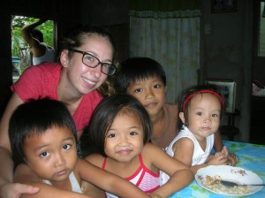Marquette graduate Colleen Ross poses with children at Casa Bayanihan, Philippines, during her study abroad trip to the area. Photo courtesy of the Office of International Education. Photo courtesy of the Office of International Education.