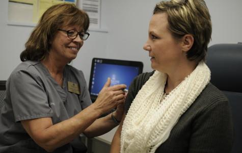 Medical clinic delivers flu shots, combats stigma around vaccinations