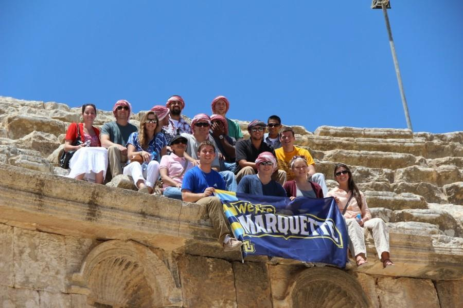 Students pose with a Marquette banner while studying in Jordan. Photo courtesy of the Office of International Education.