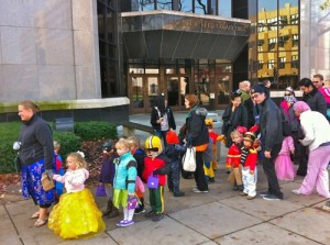 Trick-or-treaters in costume make their way past Cudahy Hall. Photo courtesy of Mykl Novak/Tumblr.