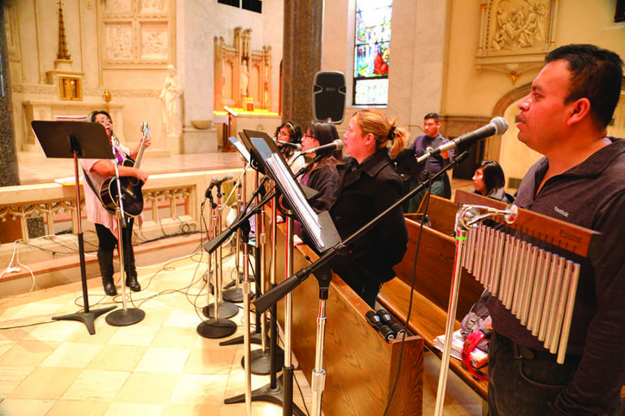 Musicians at Gesu Parish sing in Spanish during a mass in November, the third mass offered in the language by the parish. Photo by Yue Yin / yue.yin@marquette.edu