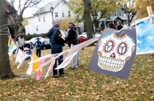 Images of skulls and skeletons decorated Walker Square Park to celebrate the Day of the Dead. (Photo by Madeline Pieschel/madeline.pieschel@marquette.edu)