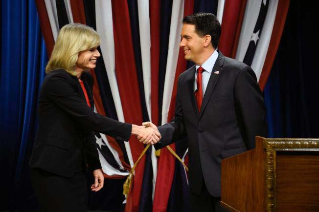 Wisconsin Republican Governor Scott Walker, right, shakes hands with Democratic challenger Mary Burke before a televised debate Friday, Oct. 17, 2014, at the WMVS-TV studio in Milwaukee. Photo by Benny Sieu / Associated Press.