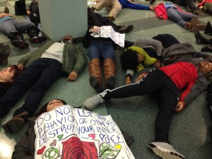 Students lay down in the Alumni Memorial Union as part of the Solidarity Die In Monday. Photo by Natalie Wickman/natalie.wickman@marquette.edu