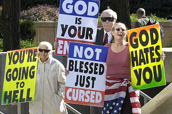 Margie M. Phelps, left, stands with her husband Pastor Fred Phelps and her daughter Margie J. Phelps during a demonstration outside the federal courthouse in Baltimore, Maryland, Wednesday, Oct. 31, 2007.  Photo by Jed Kirschbaum, Associated   Press.