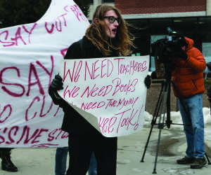 A student at the Universty of Wisconsin-Milwaukee campus demonstrates against Gov. Scott Walker's proposed budget cuts. Photo by Dan Barrett / Special to the Wire.