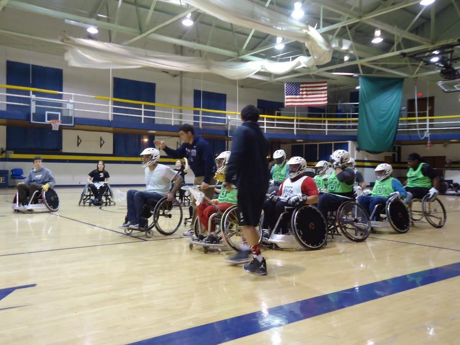 Members of the Adaptive Abilities Club practice lacrosse with men's lacrosse  head coach Joe Amplo.
