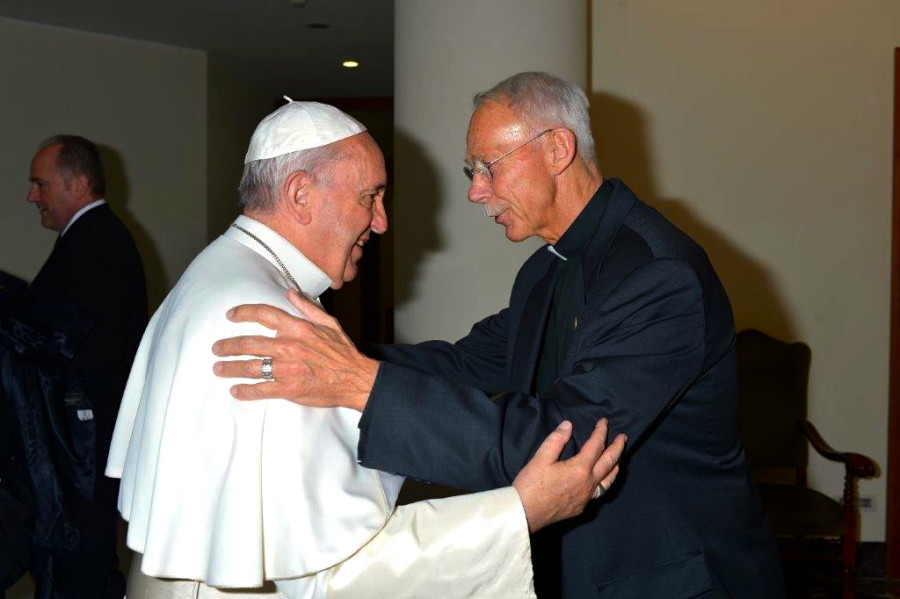 Pope Francis embraces the Rev. John Schlegel after mass last year. Photo courtesy of John Schlegel.