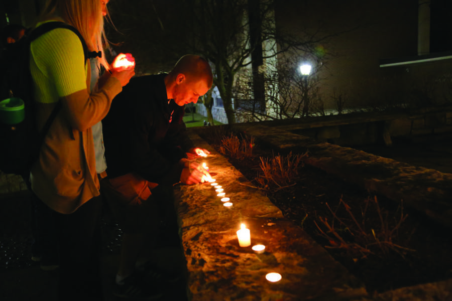 An estimated 400 students lined candles outside the Joan of Arc Chapel Monday night in memorial of visiting Assistant Professor Elena Ivanova. Photo by Yue Yin / yue.yin@marquette.edu.