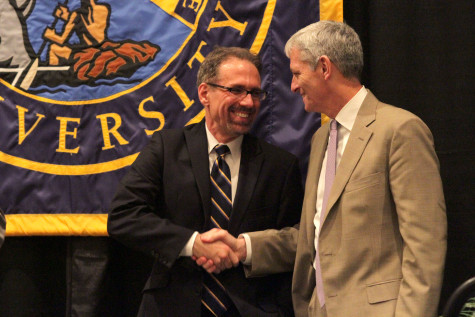 Provost Daniel Myers (left) and University President Michael Lovell (right) shake hands. Photo by Vale Cardenas.