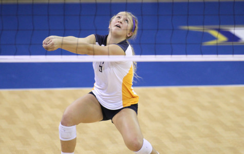 Ellen Hays digs an attack. Photo courtesy Maggie Bean/Marquette Athletics