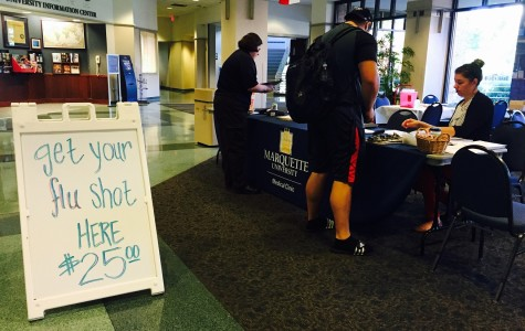 Nursing students administer flu shots to Marquette community