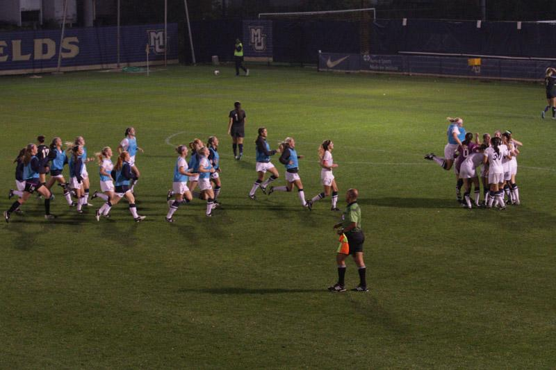 Women%27s+soccer+celebrates+after+Cali+Pyzdrowski%27s+golden+goal+in+the+92nd+minute.+Photo+by+Doug+Peters%2Fdouglas.peters%40marquette.edu
