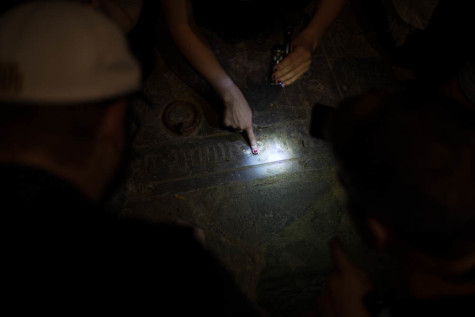 The engraving on the tomb is faint, and can only be partially deciphered.
