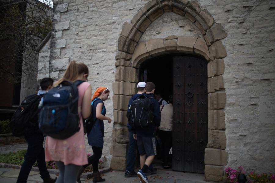 A Marquette Latin class attempts to decipher mysterious writing on a tomb in the Joan of Arc Chapel.