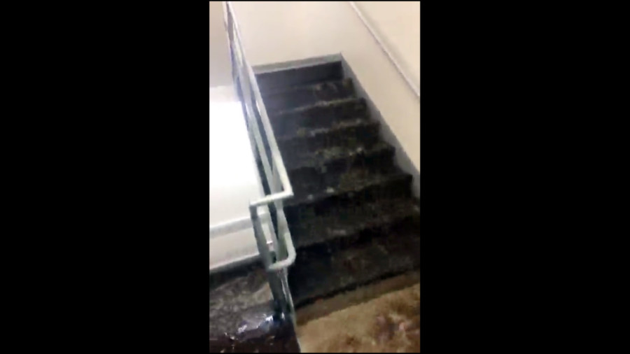 A+Snapchat+image+of+the+flooding+in+the+Schroeder+Hall+stairwell.+Wire+stock+photo.