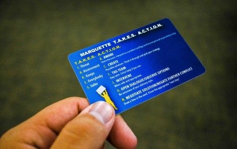 Students at the training sessions receive plastic, wallet-sized cards with intervention strategies and engagement phrases on them. Photo by Matthew Serafin /matthew.serafin@marquette.edu