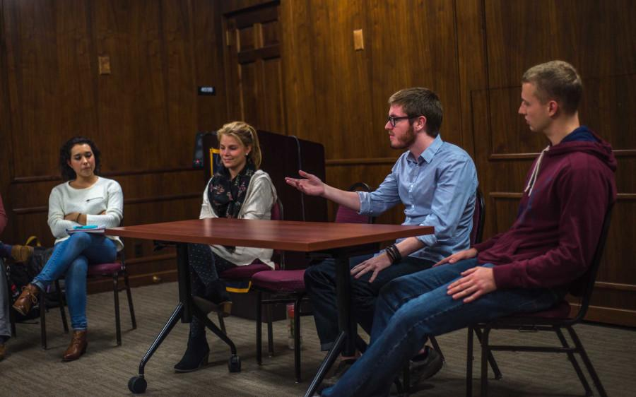Students gather to talk about their experiences returning home after studying abroad. Left to right: Sophia Boyd, Monika Cinch, John Tobin, and Cody Bauer