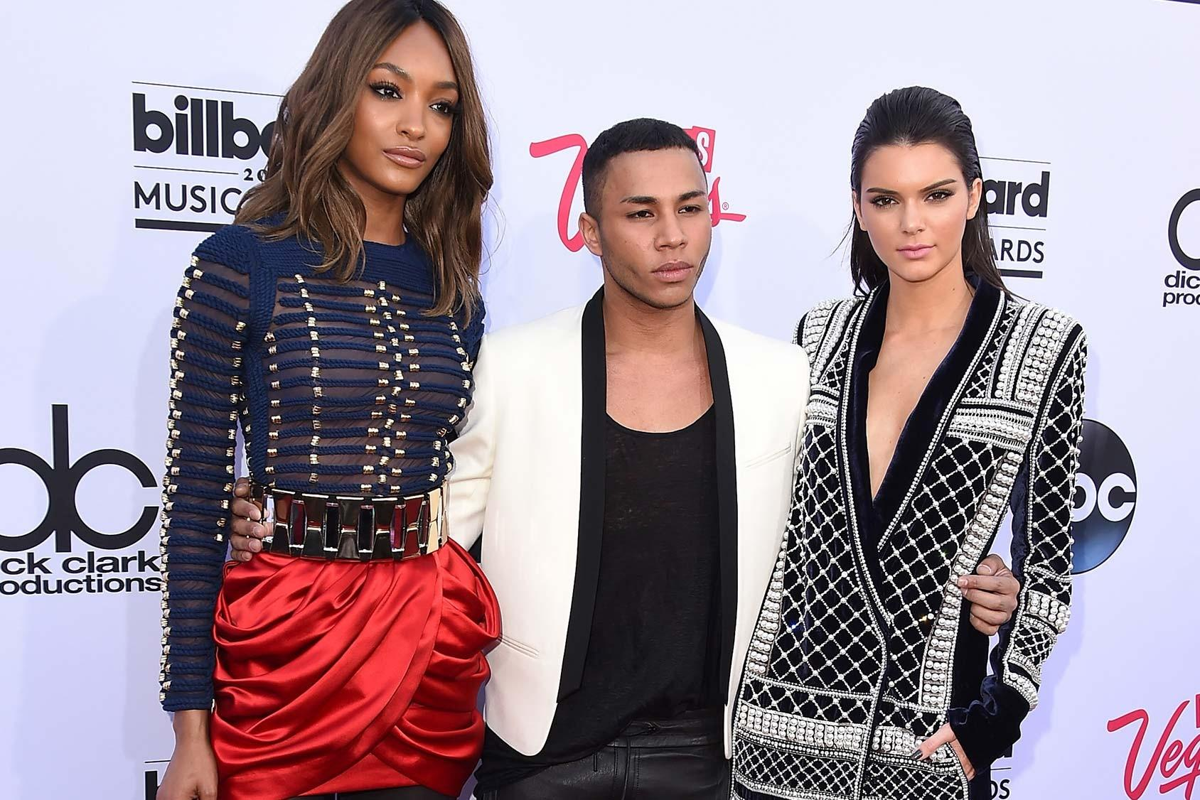 Olivier Rousteing, Balmain's creative director, poses with Kendall Jenner and Jourdan Dunn, following the announcement of the Balmain and H&M collaboration